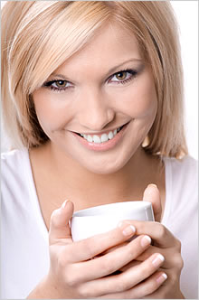 Image of woman with coffee cup